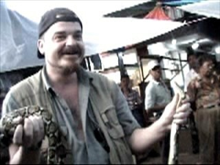 Holding a python on a break in Indonesia